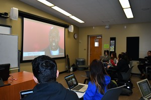 Students in Laura Guardino's U.S. History and Government (HIST 15A) course watch a short video in a 'smart classroom' in Sweeney Hall.