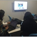 Students use a library study space with new furniture and video screens that support collaboration.
