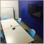 New furniture and video screens are installed in library study rooms.