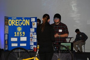 Doug Lukanc, right, talked with a guest about Oregon breweries at the SJSU Beer Appreciation class' Beers Around the World Event in Fall 2014.