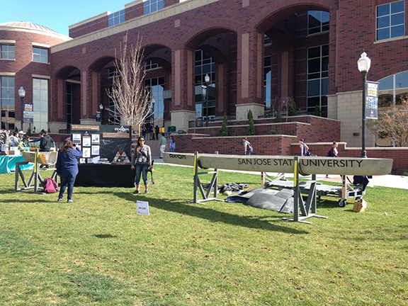 SJSU students display their concrete canoe and information on how they built it at the conference.