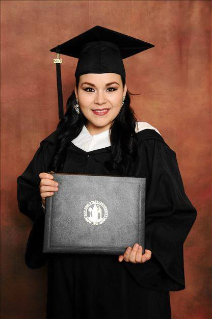 Xochlit Garcia poses in her cap and gown as she prepares to graduate with a master's in counseling education.