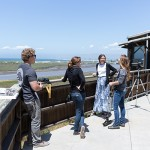 Visitors look at the view of Moss Landing.