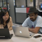 College student success centers provide general education advisement and other resources for students. Here, Career Center Advisor Lynn Chang discusses potential career paths with Raghev Srivastava, '15 Philosophy.