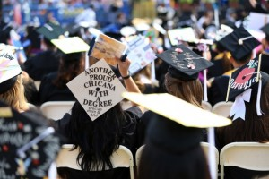 Students don decorated caps at San Jose State University's 2016 Commencement.