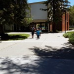 YMCA students walk through the breezeway between Spartan Complex and Uchida Hall on June 24.