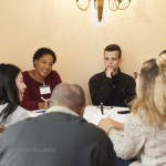 Eve Allums, in red, talks with other students at the Global Citizenship Alliance in Salzburg, Austria.