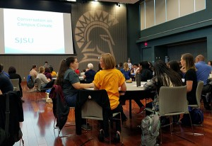 Students, faculty, staff and community members gathered for a Conversation on Campus Climate on Sept. 29, with facilitators in yellow shirts leading small group discussions.