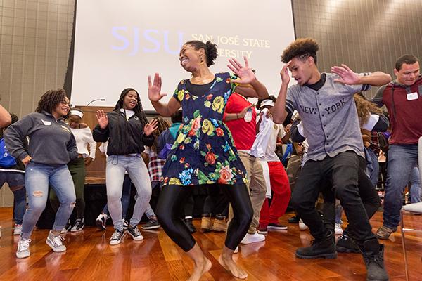 Photo: David Schmitz SJSU volunteers energize the crowd with dancing.