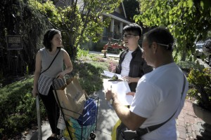 CommUniverCity volunteers canvass neighborhoods around campus to talk with residents about issues of illegal dumping and to offer alternative resources. (Photo by: Neal Waters, '07 Geography, '16 MS Mass Communications)