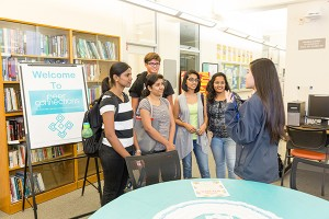 Photo: David Schmitz Students visit Peer Connections location in the Student Services Center during an open house event in September. The program offers mentors and tutors.
