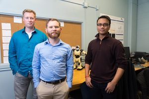 Left to right, Ian Cooke, Dr. Dave Schuster and Soham Shah pose for a photograph at San Jose State University, on Thursday, Feb. 2, 2017. Dr. Schuster has received a grant for cybersecurity research. (Photo: James Tensuan, '15 Journalism)