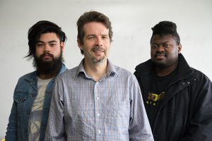 Left to right, Devin Cunningham, Dr. Aaron Romanowsky and Christopher Dixon pose for a photograph at San Jose State University, on Thursday, Feb. 2, 2017. Dr. Romanowsky is currently working with undergraduates on a research project. (Photo: James Tensuan, '15 Journalism)