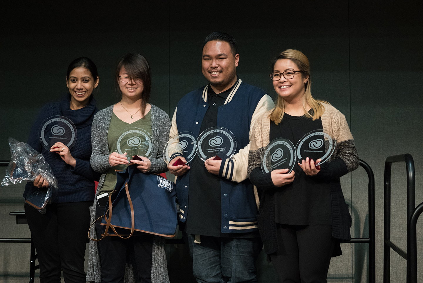 SJSU students (left to right) Vasadha Varma, Ashley Chung, Miles Vallejos and Mariella Perez were selected for best design at the Adobe CreativeJam. (Photo: James Tensuan, '15 Journalism)