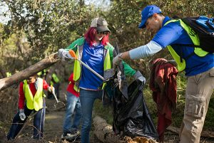 Alumnus Ralph Murrieta Jr, '11 MPA, right, and other Spartans volunteered to help with cleanup efforts following flooding along the Coyote Creek and in San Jose neighborhoods on March 11. (Photo: James Tensuan, '15 Journalism)