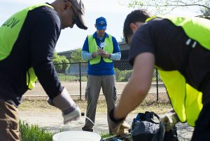 Students and alumni clean up Coyote Creek, which flooded in February. (Photo: James Tensuan, '15 Journalism)