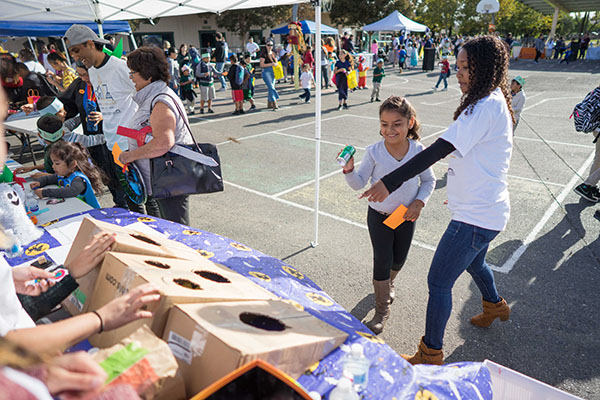 Kids learn about recycling with a can toss game. (Photo: James Tensuan, '15 Journalism)