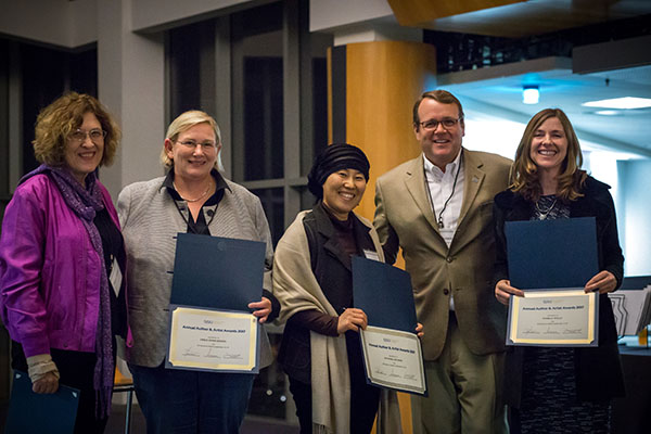 Provost Andy Feinstein, second from the right, poses with authors during a celebration Nov. 3.