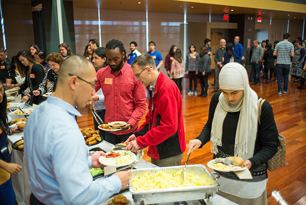 Guests help themselves to a buffet breakfast during the event. (Photo: James Tensuan, '15 Journalism)