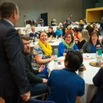 Provost Andy Feinstein laughs with staff members during the breakfast. (Photo: James Tensuan, '15 Journalism)