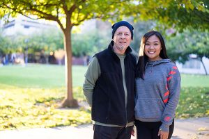 Laura Cayabyag, '17 Sociology, right, served as president of student organization COOP SJSU and poses for a photo with the group's faculty advisor Michael Fallon.(Photo: James Tensuan, '15 Journalism)