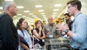 Facebook's Mark Roenigk (left) with SJSU student engineers at the soft launch of the Innovation Design Collaborative at San Jose State University on Friday, June, 8, 2018. (James Tensuan/San Jose State University)