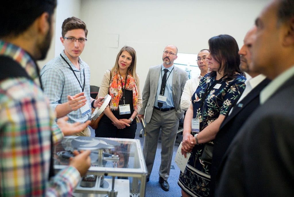 Academic leaders and industry partners talk with members of SJSU's Spartan Hyperloop team at the Innovation Design Collaborative at San Jose State on Friday, June, 8, 2018. (James Tensuan/San Jose State University)