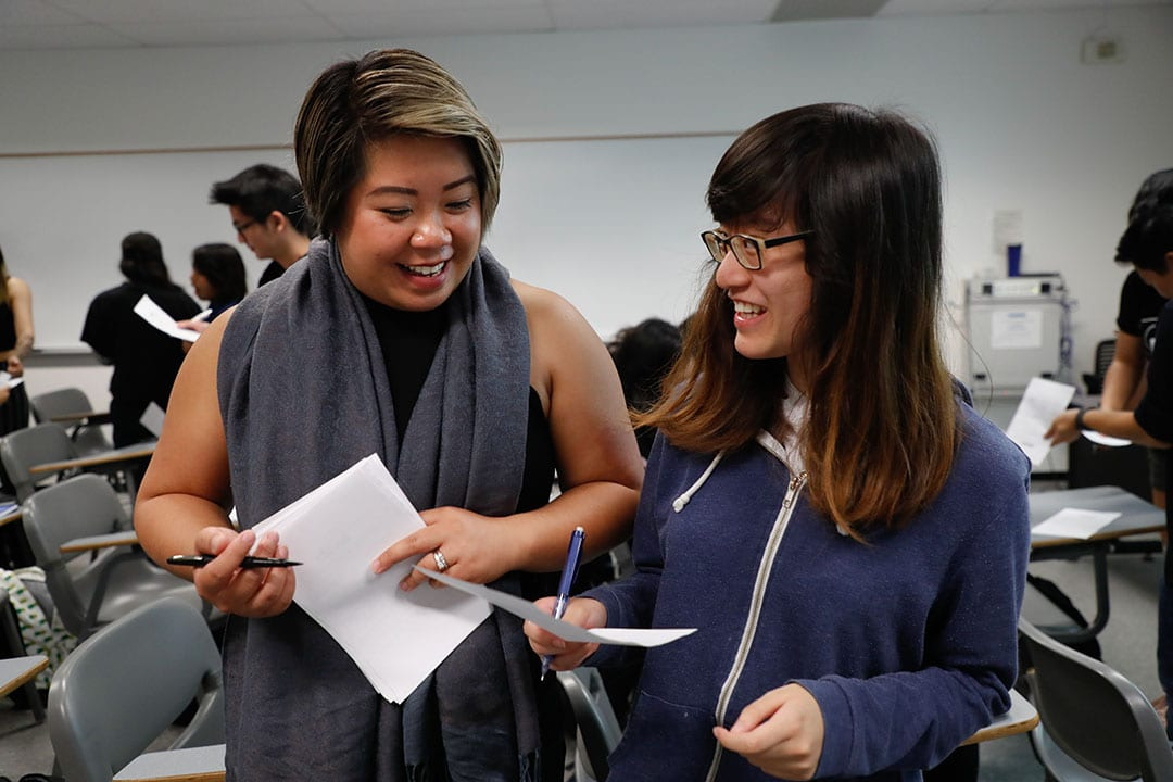 Yvonne Kwan interacts with a student in Clark Hall on Wednesday, Aug. 22, 2018. (Photo: Jim Gensheimer)