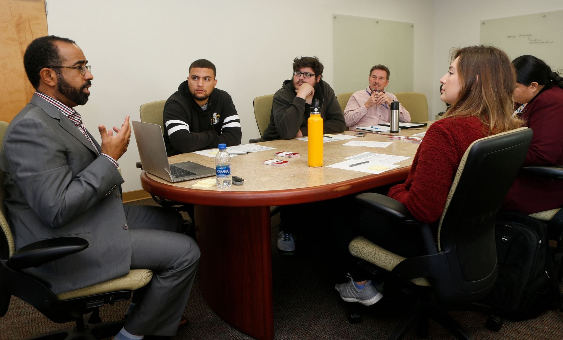 Don Fraser, Jr., left, education designer, director of micro-credentialing, of Education Design Lab, explains the digital badge concept to a student focus group. ( Josie Lepe/San Jose State University )