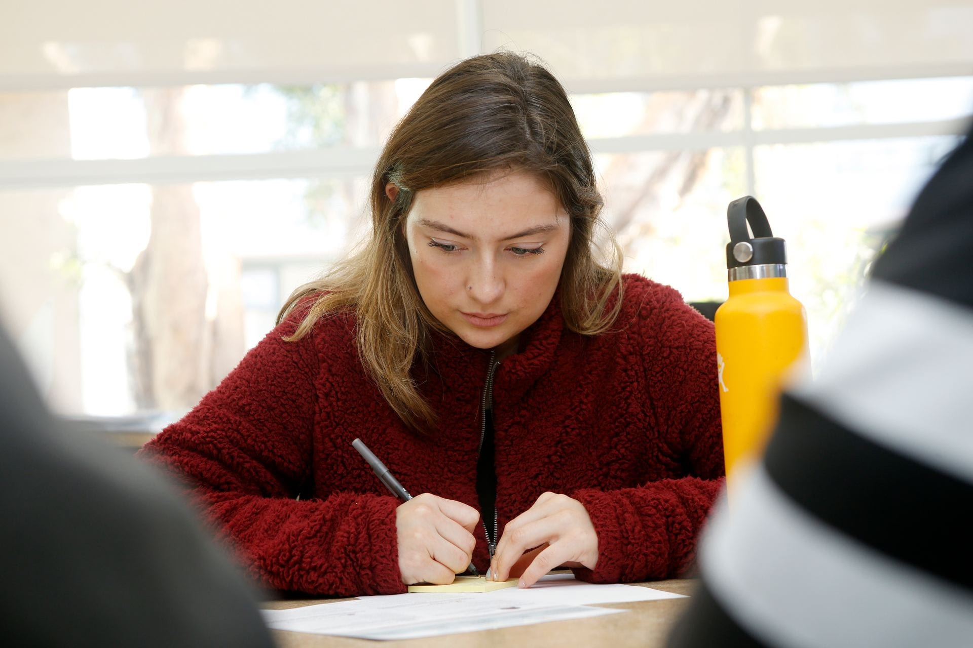 Lyzett Levenant, a senior biology major, participated in a focus group with Education Design Lab to help SJSU select two digital badges to pilot in the spring. ( Josie Lepe/San Jose State University )
