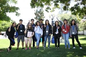 Incoming students pose for a photo with their orientation leader at San Jose State University on Thursday, June 28, 2018. (Photo: Jim Gensheimer)