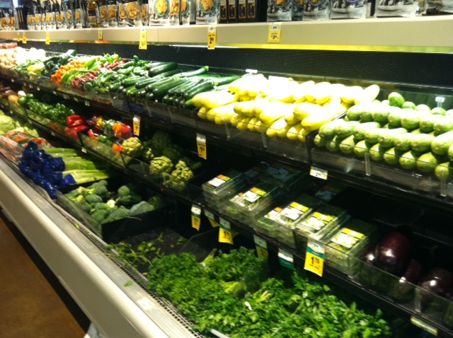 A picture of produce including squash, cucumbers, and artichokes at the Safeway Market grocery store