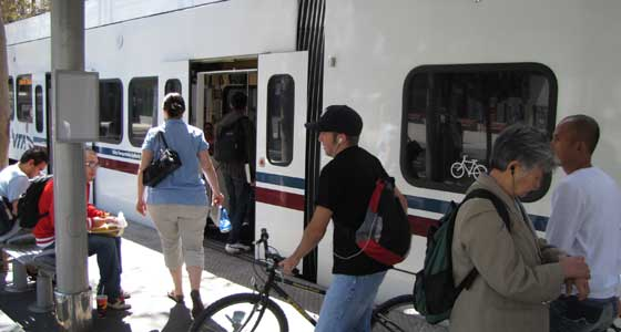 Passengers boarding VTA light rail.