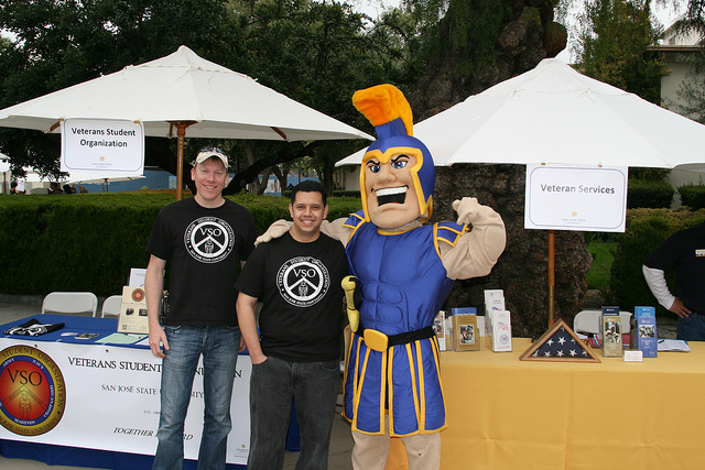 Student vets visit with Sammy the SJSU mascot outside their student activities fair both.