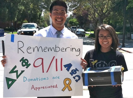Young man and woman carrying a sign and collection box.