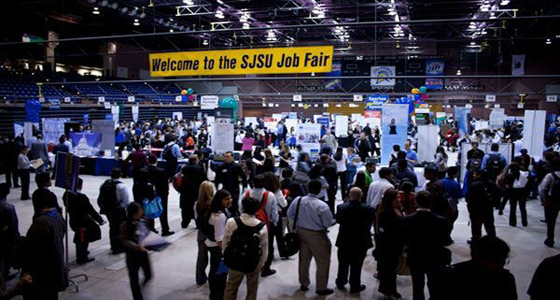 Crowds of students and alumni visit employers' booths and tables at a previous job fair in the Event Center. Photo courtesy of Career Center.