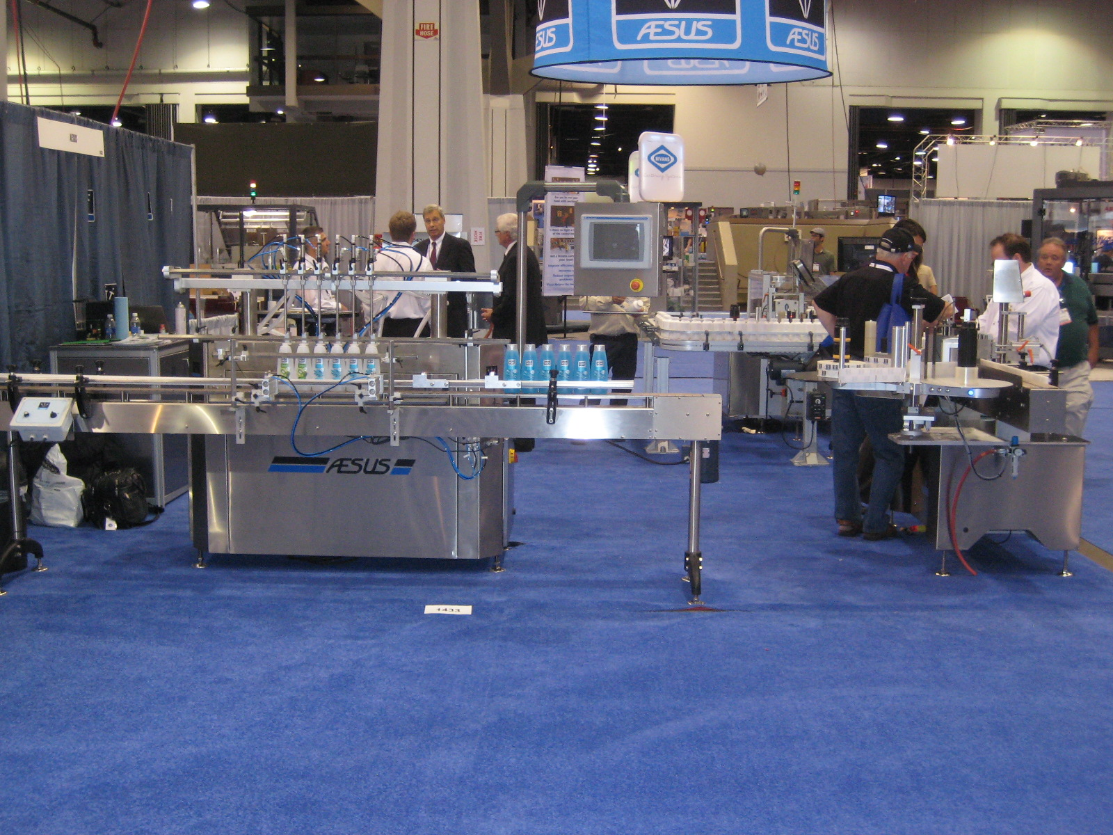 A filler machine at the Pack Expo in Las Vegas. Attendants are showing visitors how the bottles are filled on a packaging line