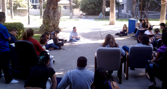 Mentor Felipe Ponce, background, hosts a study session with Mexican-American Studies students outside of Yoshihiro Uchida Hall. Courtesy photo.