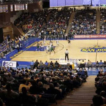 Picture of an SJSU basketball game being played at spartan stadium with a crowd of people watching in the audience.