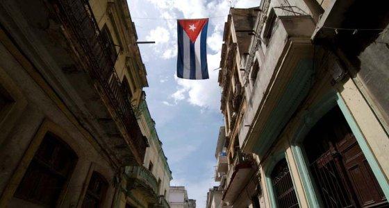 Cuban flag flying between colonial era buidings, Michael Cheers photo