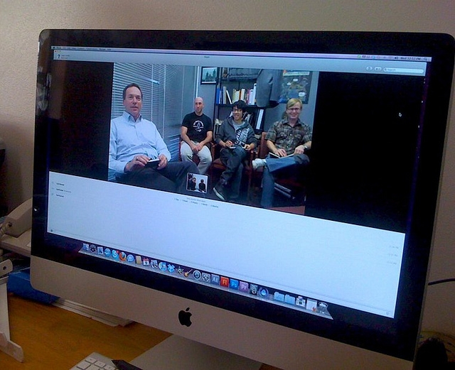 computer screen showing students working via Skype