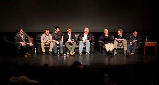 A group of men sit on dark-let stage at San Jose Repertory Theatre for Cinequest's Rough Cut Forum. Photo by Dillon Adams