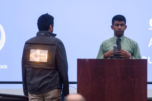 A student demonstrates Night Square during the Elevator Pitch Competition (Robert C. Bain photo).