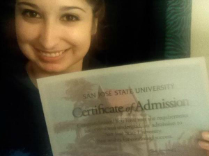 student with admissions certificate