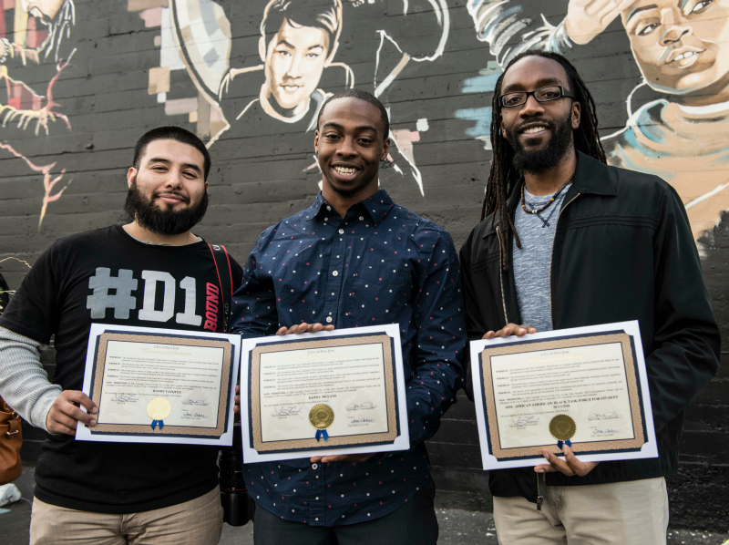 Randy Vazquez, senior journalism major; Danny McLane, junior industrial systems engineer major and Jahmal C. Williams, Spartan Connect Coordinator, Peer Connections, pose with their community service certificates presented by the City of San Jose. McLane and Williams are members of the AfricanAmerican/Black Task Force. Vazquez is a member of the Latino@ Student Success Task  Force. All contributed community service hours for the recently completed SJ Downtown Community Mural project.