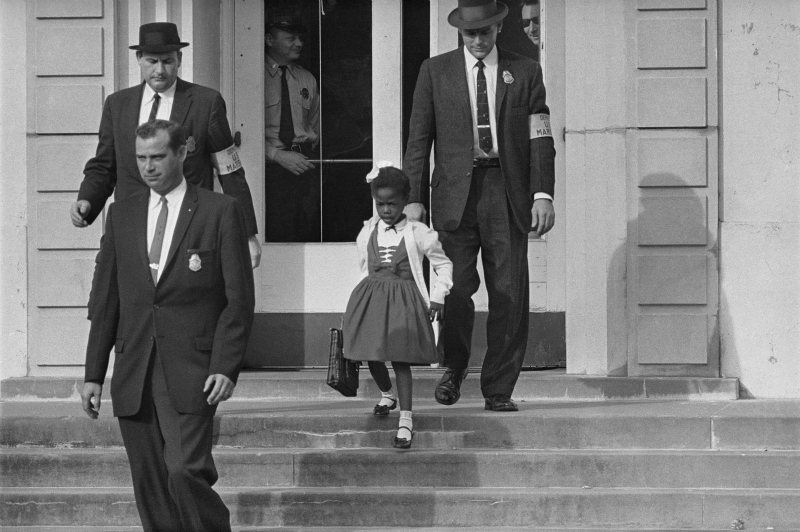 Ruby Bridges enters William Frantz Elementary School, surrounded by federal marshals (AP image).