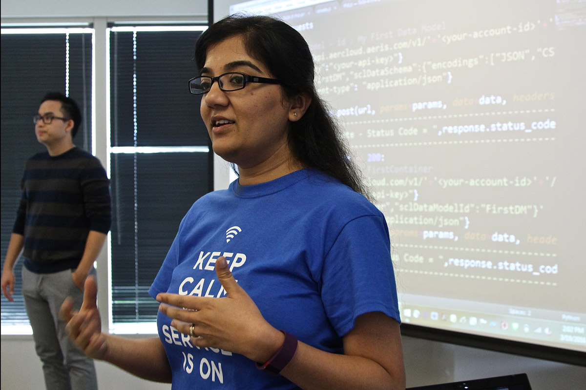 Aeris senior software engineer Maanasa Madiraju gives thirty San Jose State computer software engineering majors an introduction to downloading software needed for the workshop (Photo: Lauren Hernandez, '15 Journalism).