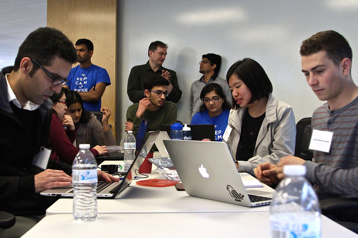 San Jose State undergraduate and graduate computer science majors whip out their laptops and begin downloading Python and JavaScript software (Photo: Lauren Hernandez, '15 Journalism).