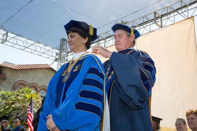 Chancellor Tim White secures a medallion President Papazian received to mark the occasion (Photo: David Schmitz).