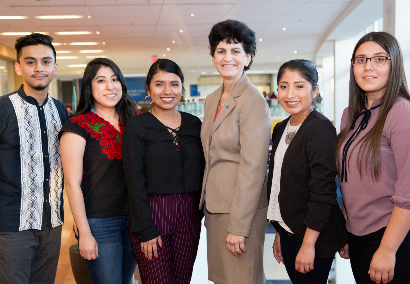 President Mary Papazian, third from the right, connects with Chicanx/Latinx Student Success Center interns Erick Macias-Chavez, Ana Ferretiz, Paola Quintanilla, Flor Sario and Janely Cerda at a spring welcome event February 5 (photo by David Schmitz).